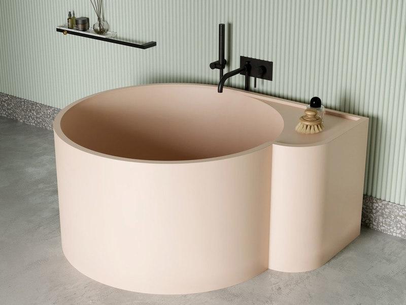 Vasca da bagno rotonda rosa per arredare bagno piccolo